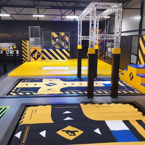 Trapeze trampoline park with airbag